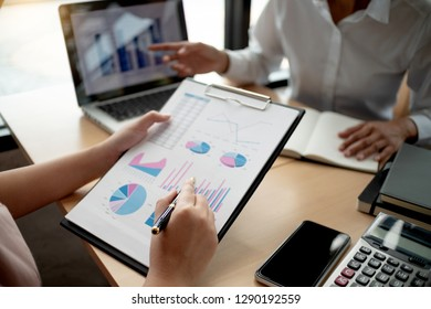 business executives negotiate meeting in modern office discussing a quality data.