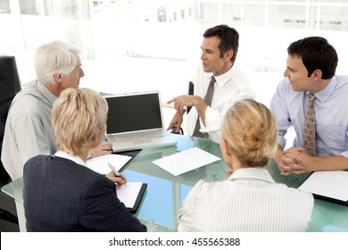 Business executives presentation on laptop at a corporate meeting with ceo