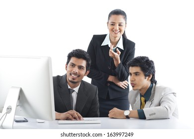 Business executives working on desktop pc