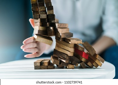 business failuare ideas concept with girl hand smash wooden stack block on ground with anger