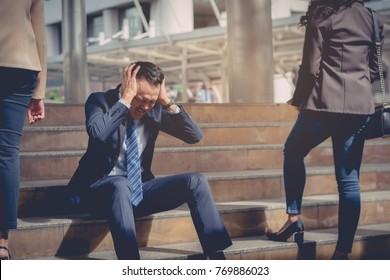 business failure concept : businessman stressed sitting ,problem life balance ,selective focus