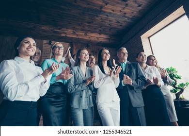 Business family concept. Photo of ecstatic elegant in classic suit jacket blazer confident crowd clapping hands stand look at speaker boss chief ceo chairman in loft interior room