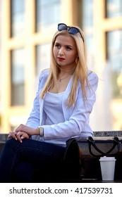 Business , fashion concept . Young stylish businesswoman portrait  against  urban background.