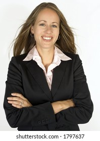 A business female is looking confident standing with her arms crossed