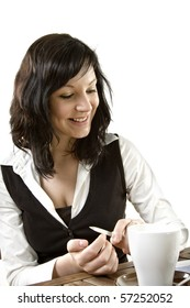 Business female with nail file, coffee cup an newspaper in a break