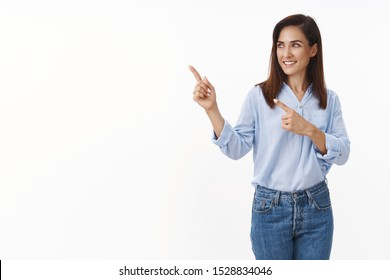 Business, feminism, confidence concept. Motivated good-looking stylish female entrepreneur introduce chart, pointing sideways left copyspace, turn aside smiling pleased, show promo, white background