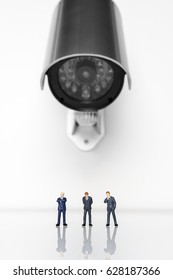 Business figures being watched by a security camera