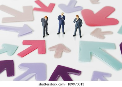 Business figurines with arrows