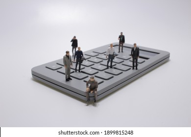 Business figurines placed on calculate, the Business idea