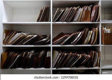 Business files in boxes folders and shelf papers