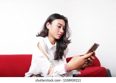 business filipino woman using smartphone on white background