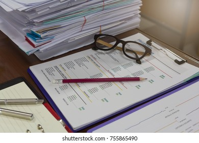 Business and finance concept of analysis chart on office desk with stack of business paper background