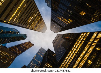 Business and finance concept, looking up at modern office building architecture and high rise corporate buildings in the financial district, Downtown Toronto, Ontario, Canada.