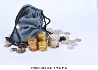 Business and finance concept. Money bag with coins on a white background.Selective focus.