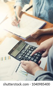 Business and finance concept of office working, Businessman using calculator to discussing sale analysis Chart