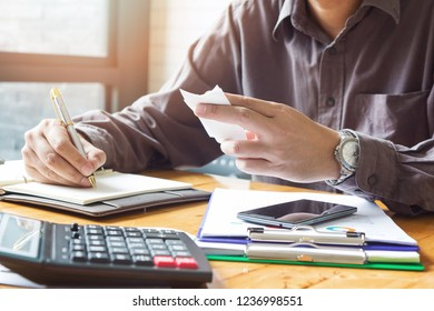 Business and finance concept of office working, Businessman using calculator to calculate bill payment