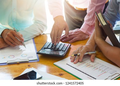 Business and finance concept of office working, Team of Businessmen discussing analysis Chart