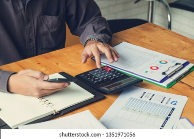 Business and finance concept of office working, Businessman using smartphone and discussing investment business plan in office