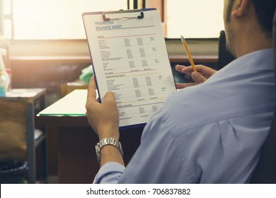 Business and finance concept of office working, Businessman discussing Projected Balance sheet chart, Vintage effect