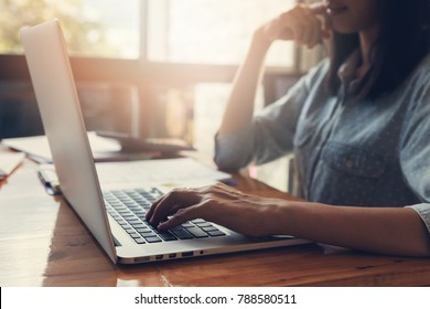 Business and finance concept of office working, Businessman using laptop to discussing sale analysis Chart