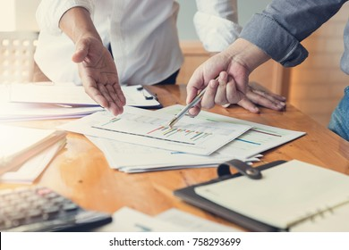 Business and finance concept of office working,Teamwork of Businessmen discussing analysis Chart