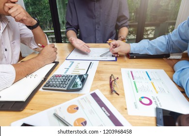 Business and finance concept of office working,Top view of Teamwork of Businessmen discussing business investment plan in office