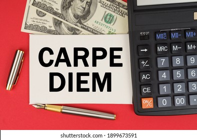 Business and finance concept. On a red background, among the money, a calculator and a pen lies a sign with the text - CARPE DIEM