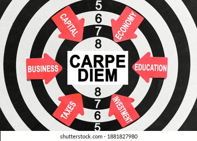 Business and finance concept. On the target, arrows with business lettering point to the center on a business card with the inscription - CARPE DIEM