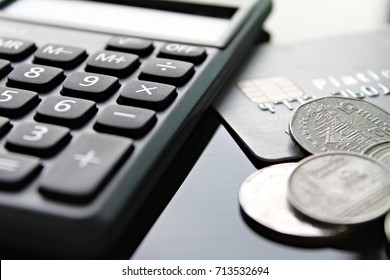 Business, finance, credit card, shopping, saving money, banking, loan, investment, taxes or accounting concept : Credit card, calculator and coins on office desk table