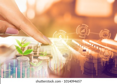 business and finance growth concept background with woman hand working on computer laptop with abstract technology ,financial graph