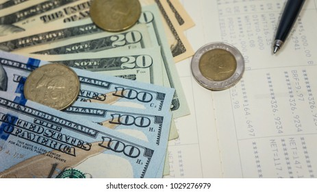 Business, finance, investment, accounting or money exchange concept : American Dollars cash money, calculator on savings account passbook or financial statement