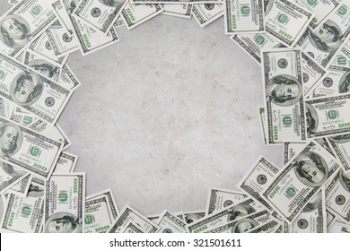 business, finance, investment, saving and corruption concept - close up of dollar money over concrete background