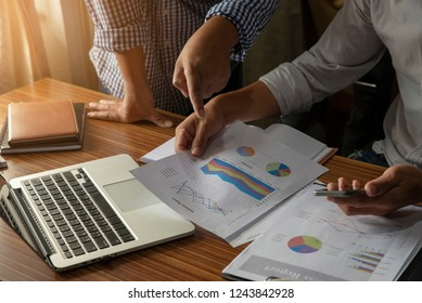 Business and finance planner concept.Financial adviser planning and working on laptop,Businessman typing and review annual report at office.Annual report,notebook on wooden table