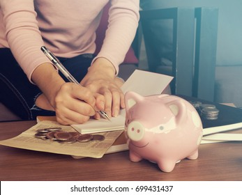Business, finance, saving or investment concept.Close up of people hand work calculator and money,coins in finance banking and saving concept.