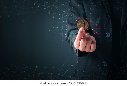 Business and Finance, Savings, Investing with Digital Assets, Future finance, blockchain. Business man holding golden cryptocurrency coins bitcoin on financial growth chart background.