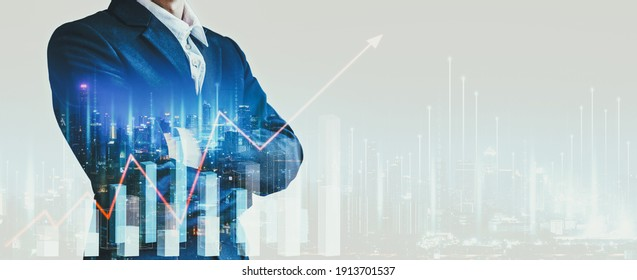 Business finance technology concept, Professional business man on network city and digital marketing chart graphic at night in Bangkok, Thailand