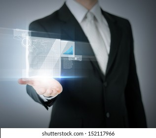 business and finances - businessman hand showing raising chart on virtual screen