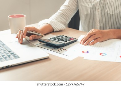 Business financial analyzing and planning calculation for investment on table desktop.,Businesswoman accountant is working and making tax document information for balancing budget and profit income.,