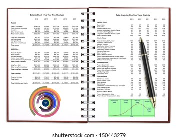 business financial chart analysis with pen on notebook, included clipping path