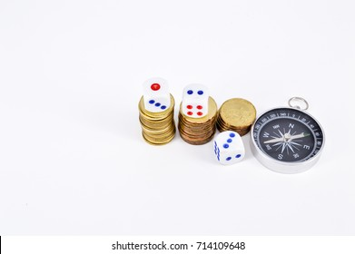 Business and Financial concept : Stack of Coins,dices and compass on white background.Selective focus.