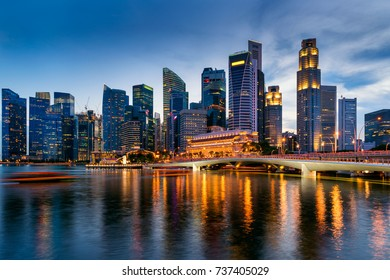 Business Financial Downtown City and Skyscrapers Tower Building at Marina Bay, Singapore, Cityscape Urban Landmark and Business Finance District Center in Twilight Scene, Capital City of Singapore.