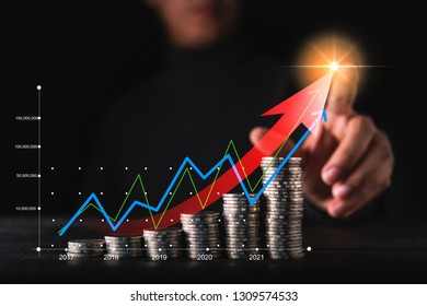 business financial ideas concept businessman hand point money coin stair stack black background with success number chart line