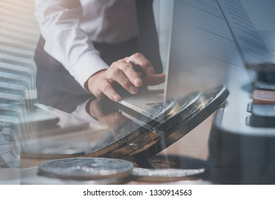 Business financial investment and technology concept, Double exposure of businessman, accountant working on laptop computer at office with coins, calculator and modern buildings office in the city
