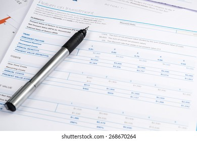 business and financial report with pen