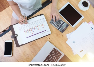 Business financing accounting banking concept. Top view of female accountant or banker making calculations. Savings, finances and economy concept