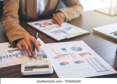 Business Financing Accounting Banking Concept, businesswoman doing finances and calculate about cost to real estate investment and in other, tax system. - Shutterstock ID 753656569