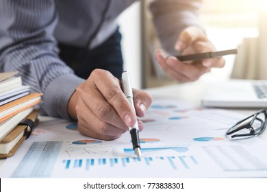 Business Financing Accounting Banking Concept, businessman using smart phone and doing finances, calculate about cost to real estate investment and in other, tax system.