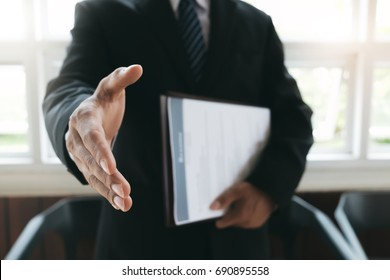 Business find new job, interview the job and hiring. Job applicant holding resume.Open handshake and resume job interview or acceptance.