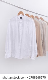 business formal linen ,white suit with white shirt and jacket on hanger