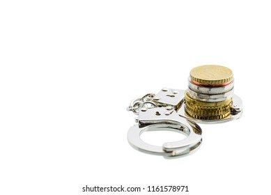 Business fraud and tax avoidance / evasion concept : Coin in a silver handcuff, depicts the use of illegal methods to modify financial situation or reports to lower or avoid paying tax. White isolated